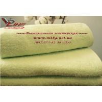 Махровое полотенце светло салатового цвета