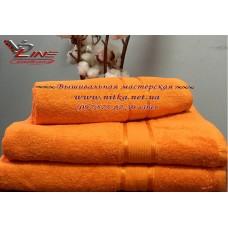 Махровое полотенце оранжевого цвета