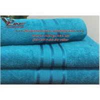 Махровое полотенце бирюзового цвета