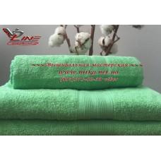 Махровое полотенце салатового цвета с бордюром