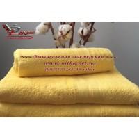 Махровое полотенце желтого цвета